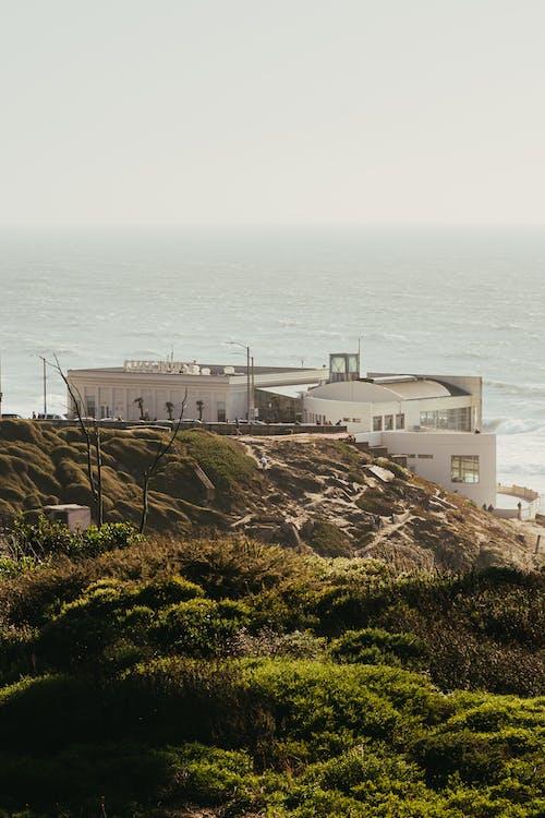 Photography of Building Beside Seashore