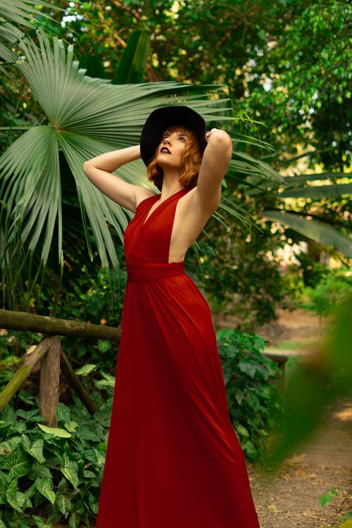 Woman Wearing Red Sleeveless Dress Posing