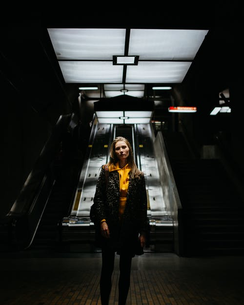 Woman Standing Inside Dark Room