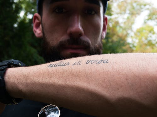 Free stock photo of armt tattoo, bearded man, cursive writing, hiking