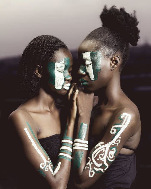 Women With Face Paints And Body Paint Art