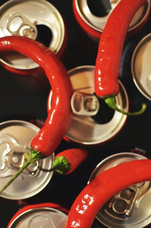 Four Red Chili on Top of Cans