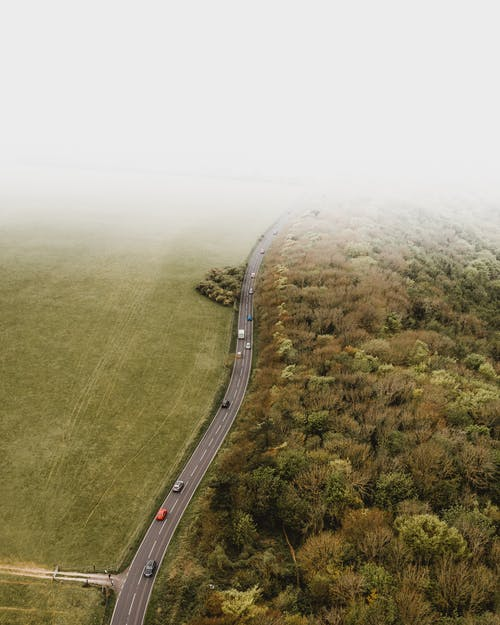 Aerial Photography of Vehicles Traveling on Road