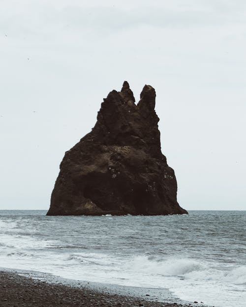A Rock Formation On The Sea Close To The Shore