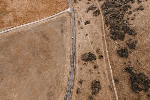 土, 景觀, 瀝青, 砂 的 免费素材照片