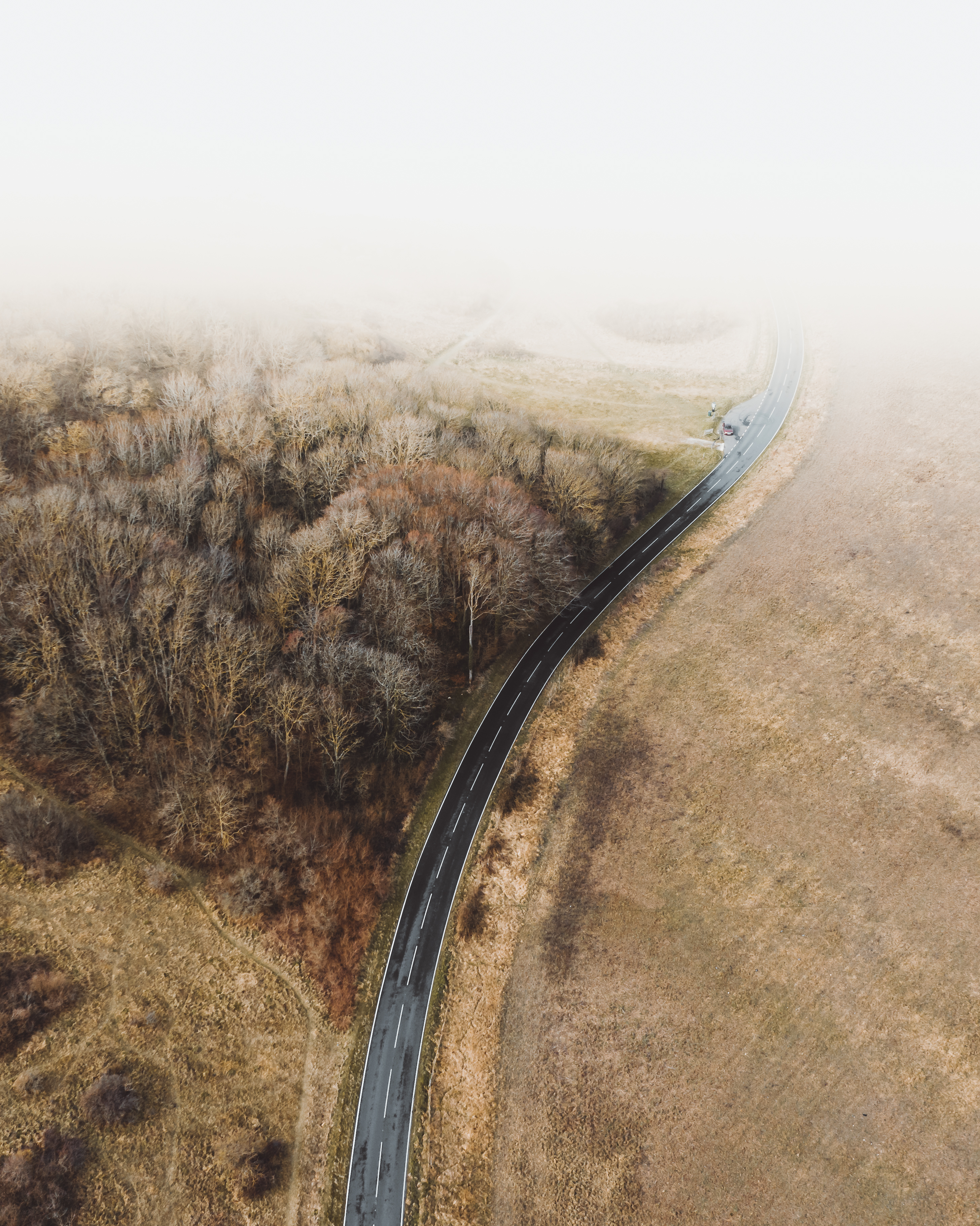 Aerial Photography of Road Near Brown Field