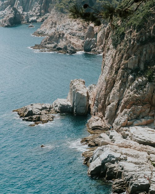 Aerial Shot Of A Rocky Mountain Cliffs By The Sea