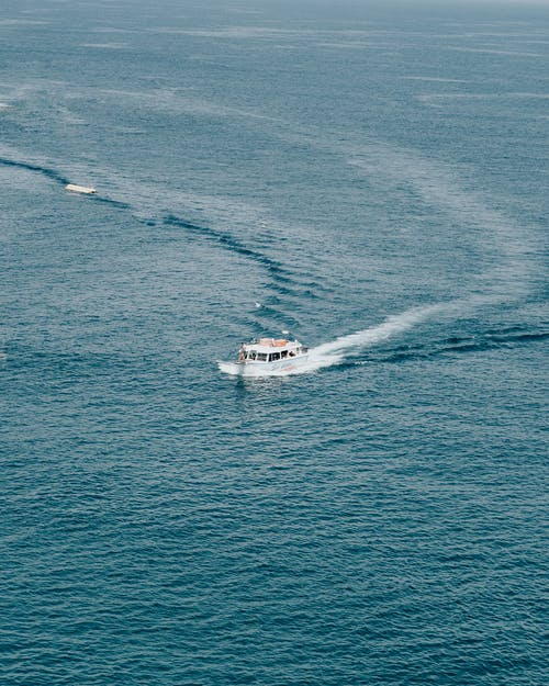 White Boat In The Middle Of The Ocean
