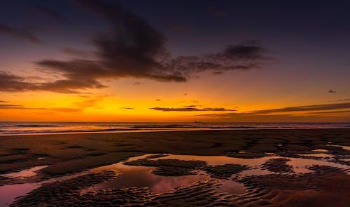 Безкоштовне стокове фото на тему «берег моря, Захід сонця, краєвид, морський пейзаж»