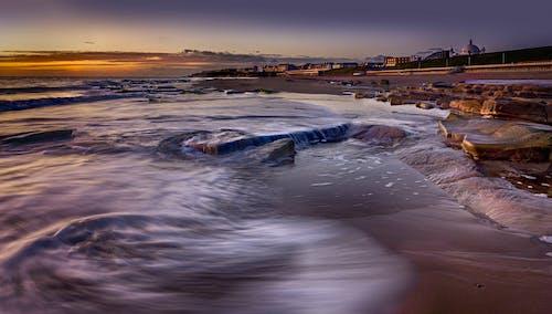 Photos gratuites de aube, bord de mer, crépuscule, mer