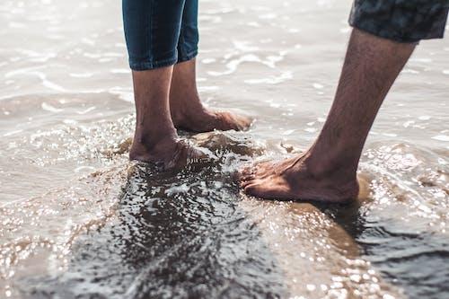 Photo of Feet on Seashore