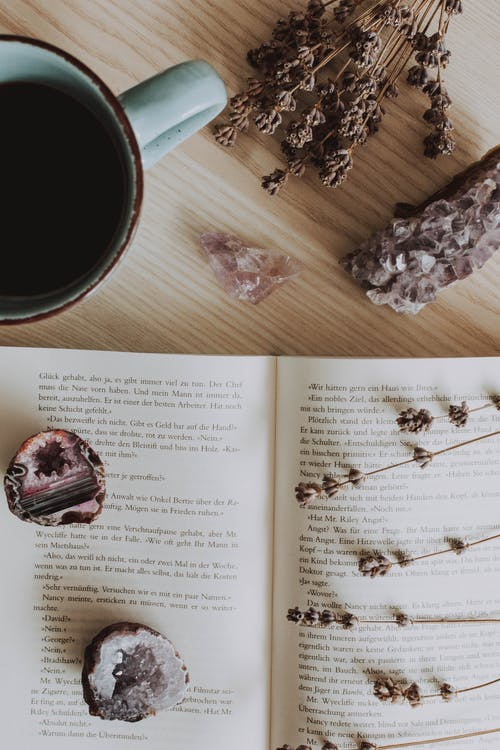 Teal Mug Near White Book