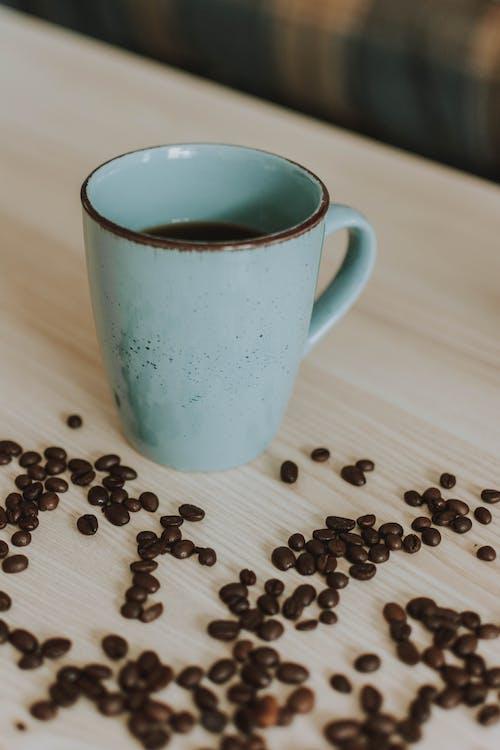 Photo of Mug Near Coffee Beans