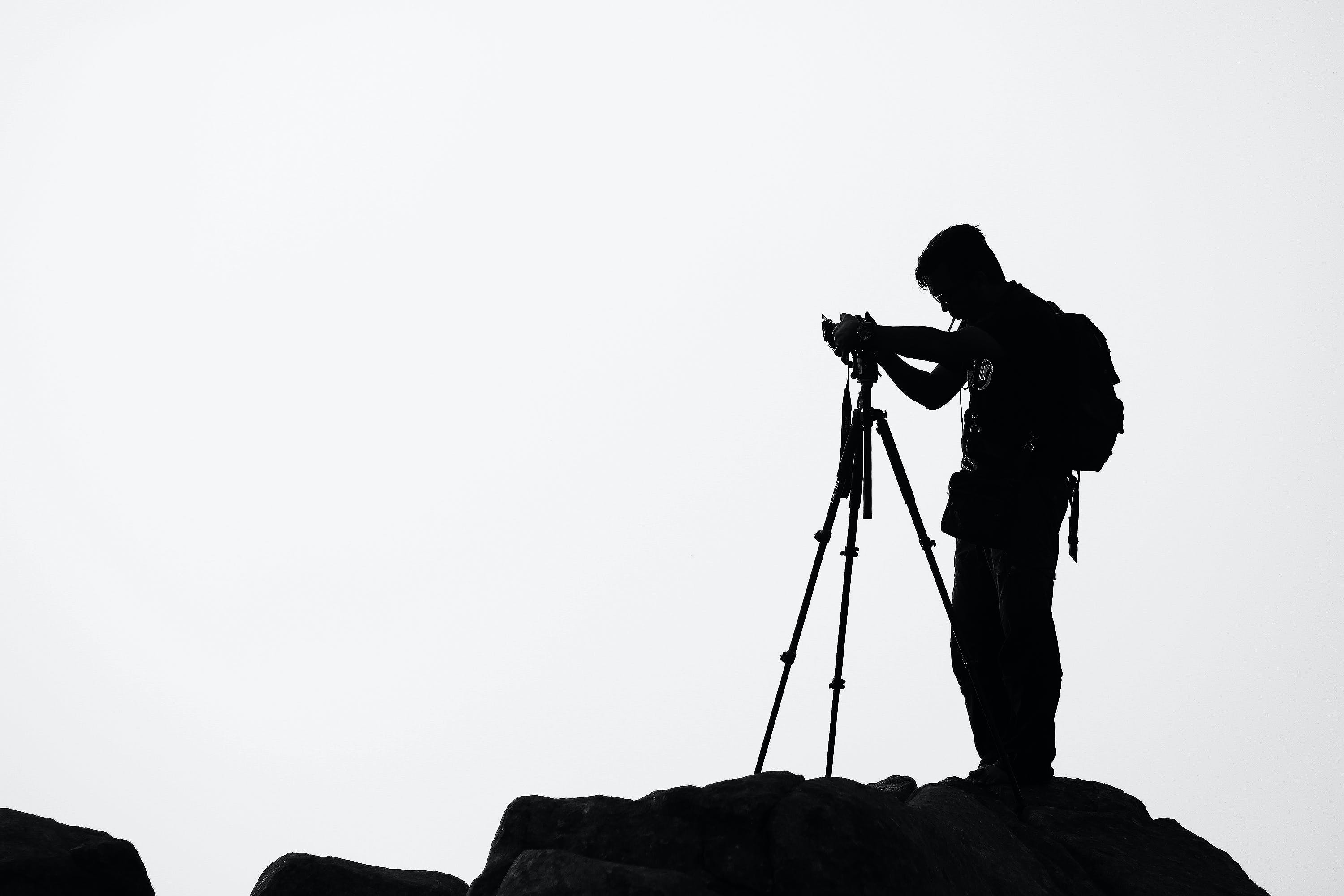 Silhouette of Man Holding Camera