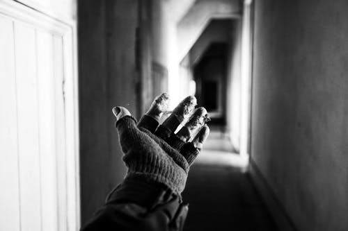 Monochrome Photo of Person's Hand