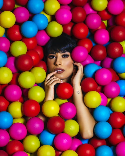 Woman Surrounded With Multicolored Balls