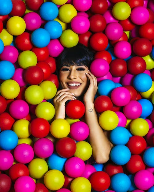 Photo of Woman Covered With Multicolored Balls