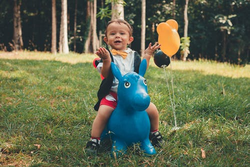 Little Boy Riding Blue Pony Toy Ride