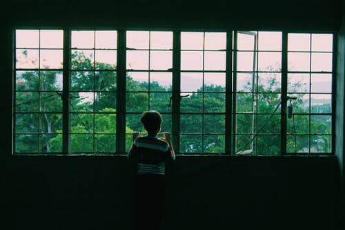 Boy Near Window