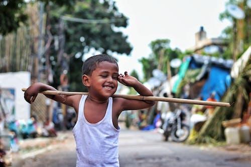Gratis stockfoto met aziatisch jongetje, Aziatisch kind, blurry achtergrond, buitenshuis