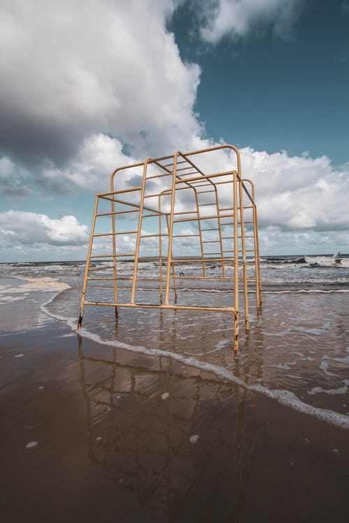 White Metal Frame on Beach