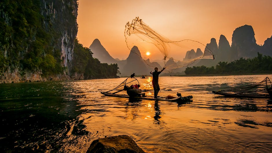 Person s on boat throwing fishing net
