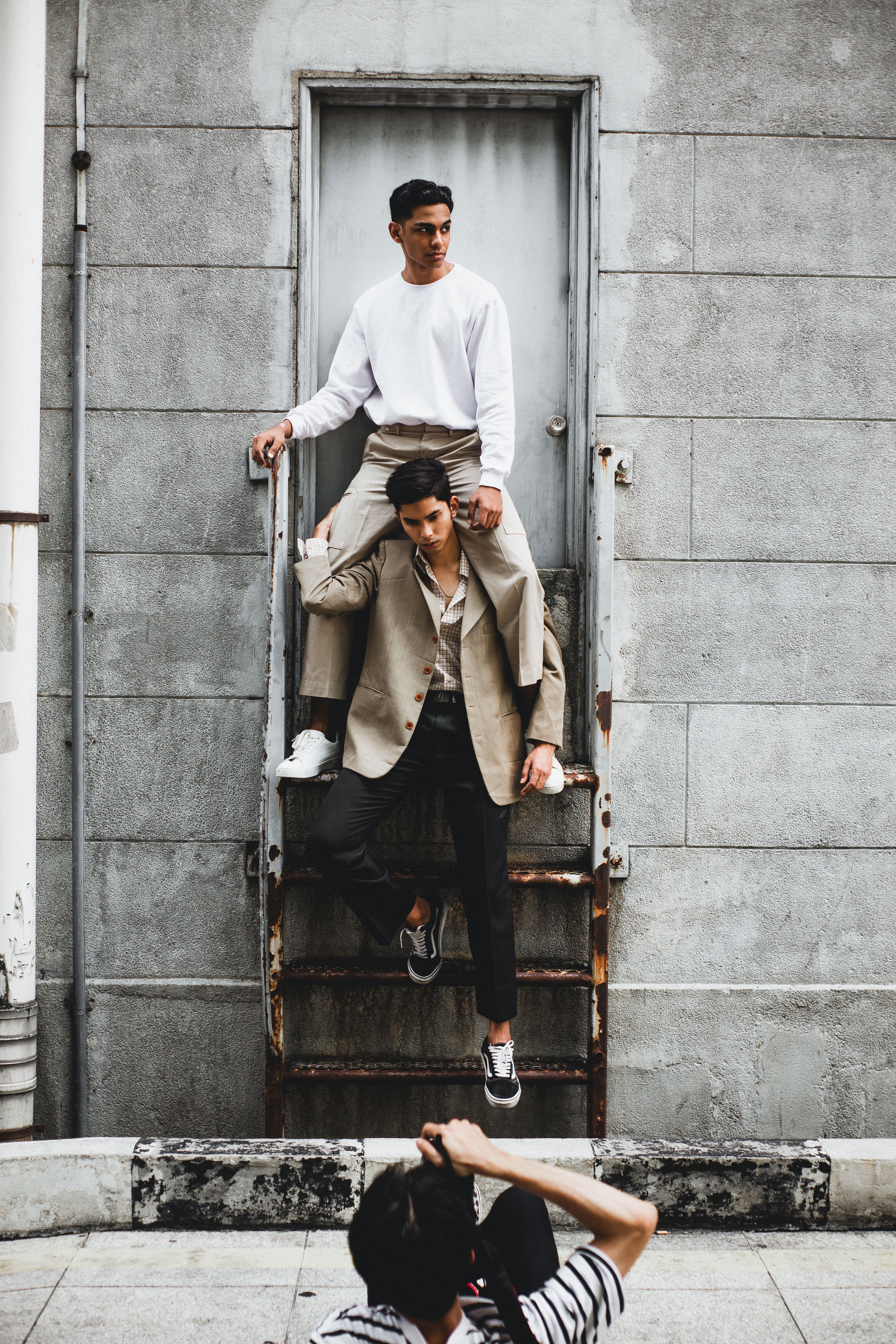Photography of Man Carrying Another Man on Stairway