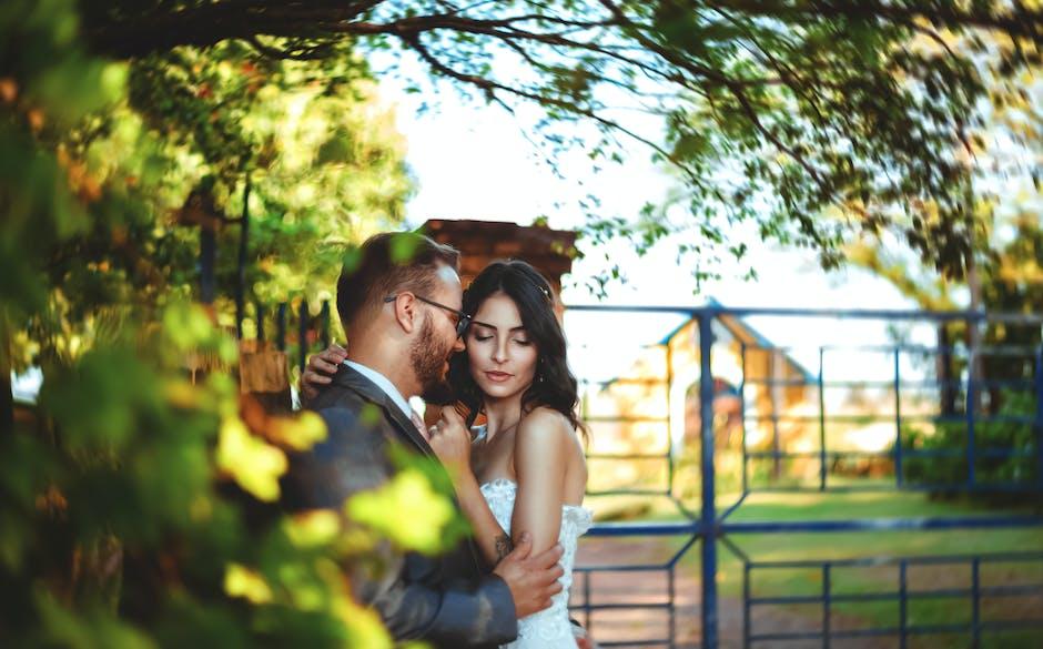 Romantic couple standing near a gate