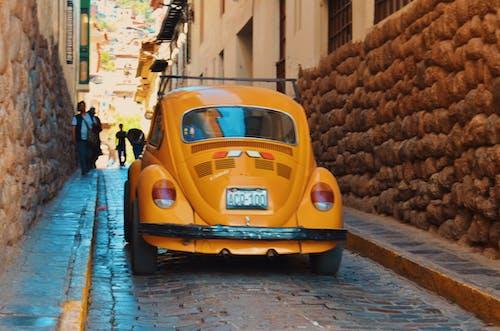 Ilmainen kuvapankkikuva tunnisteilla auto, autot, keltainen, keltainen auto