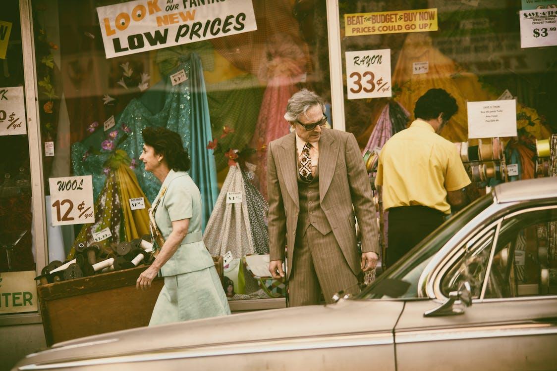 Man Looking At A Vintage Car