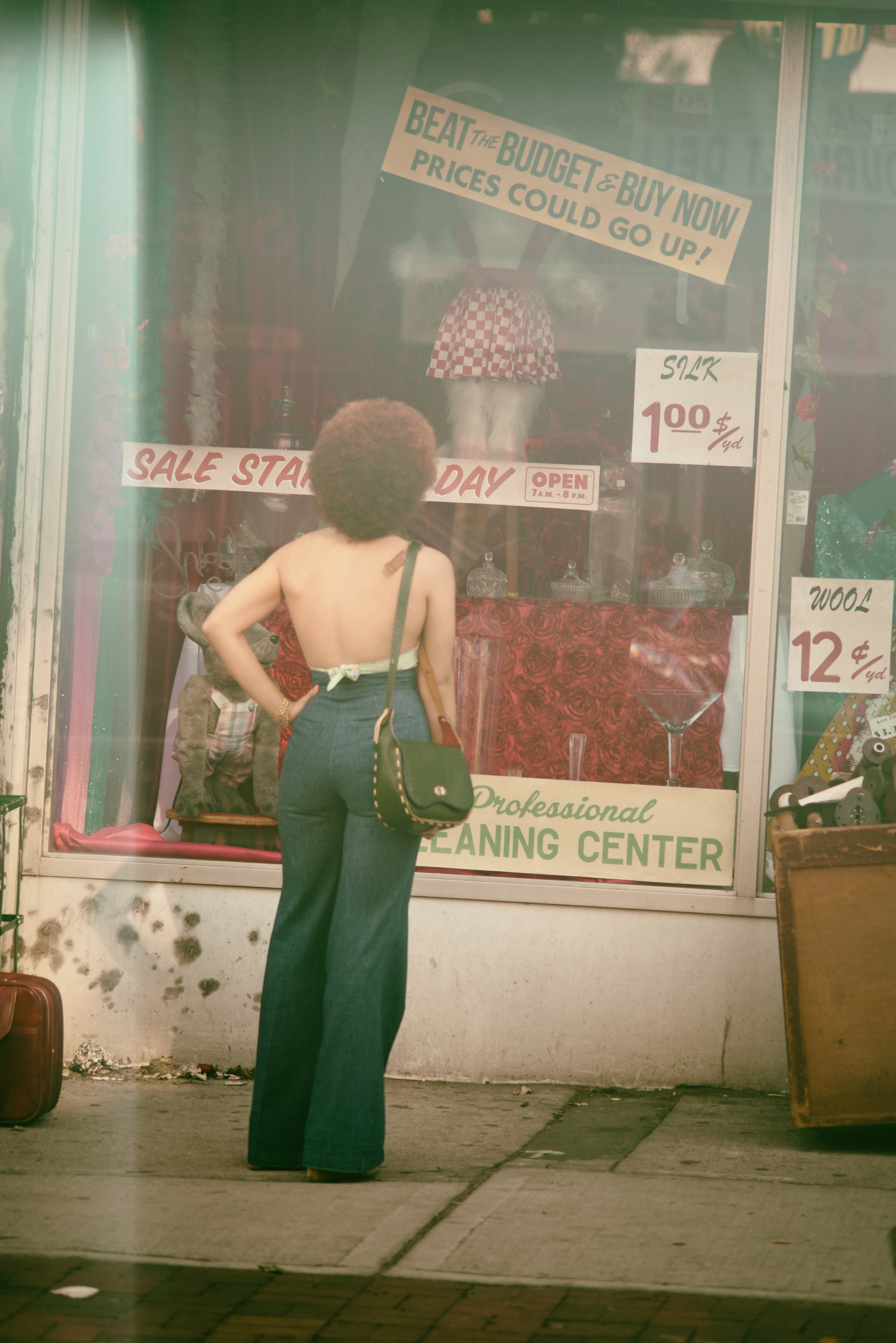 Person Standing Infront Of A Display Window