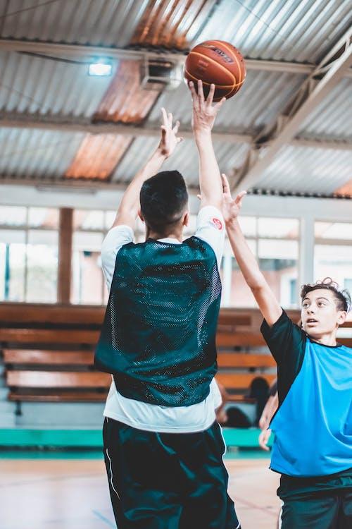 Photo Of Men Playing Basketball