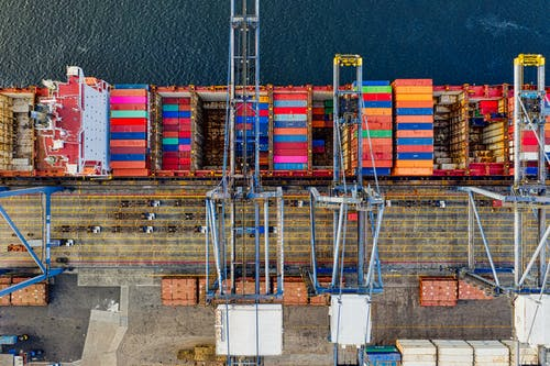 Top-view Photography of Cargo Ship With Intermodal Containers