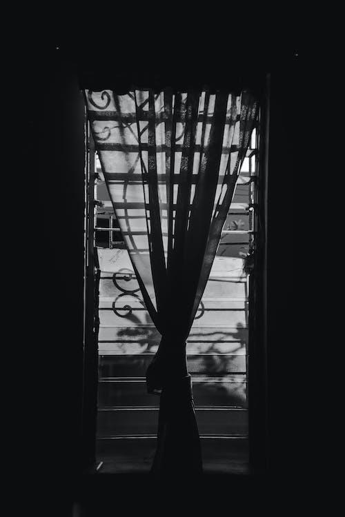 Monochrome Photo of Jalousie Window