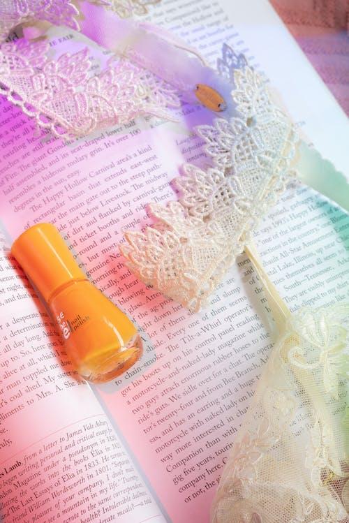 Orange Nail Polish On A Book