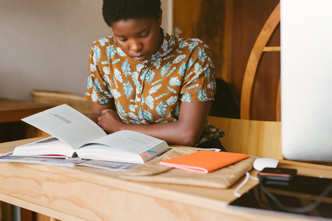 Photo Of Woman Reading Books