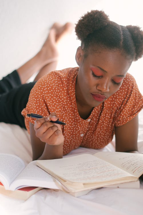Photo Of Woman Holding A Pen