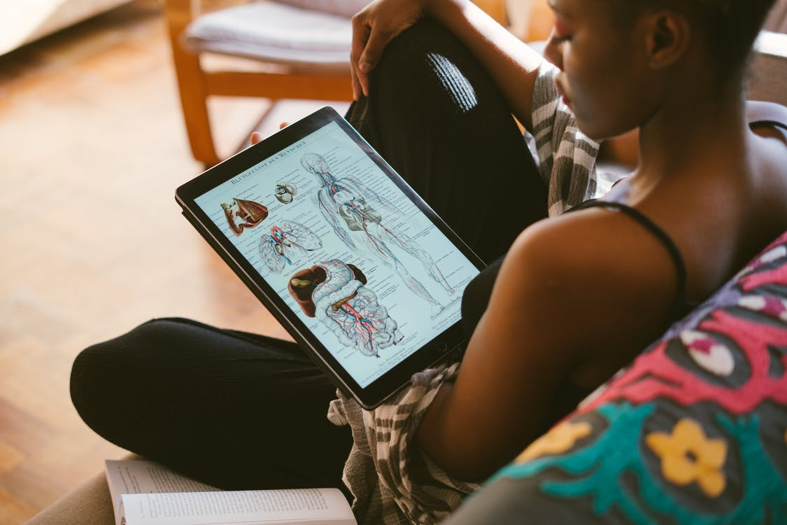Photo Of Woman Studying Anatomy