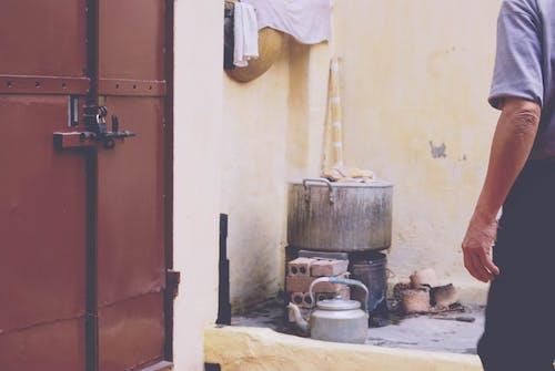 Person Standing Beside Brown Door