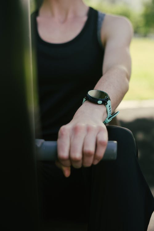 Selective Focus Photo of Person Wearing Wristwatch