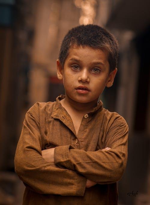 Immagine gratuita di bambino, bokeh, espressione facciale, esterno