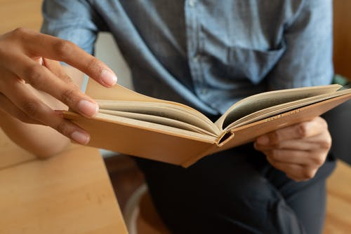 Photo Of Person Holding Book