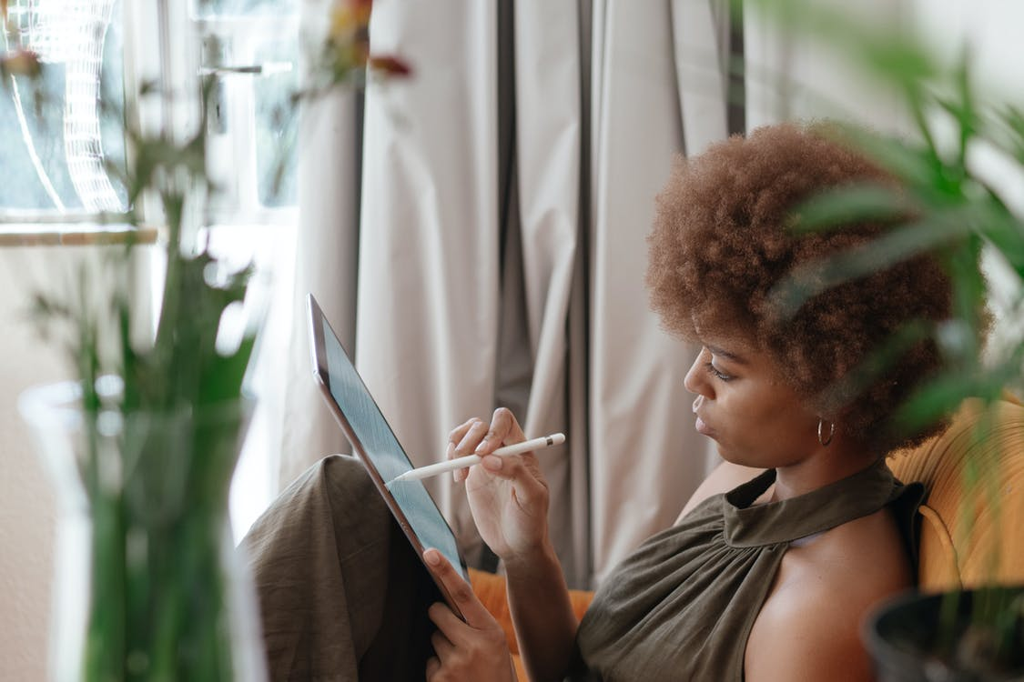 Photo Of Woman Using Tablet to Read