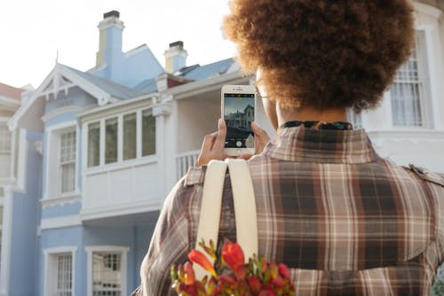 Photo Of Person Taking Picture Of House