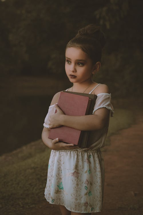 Girl Holding Books