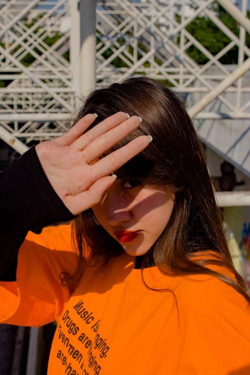 Photo Of Woman Wearing Orange Shirt