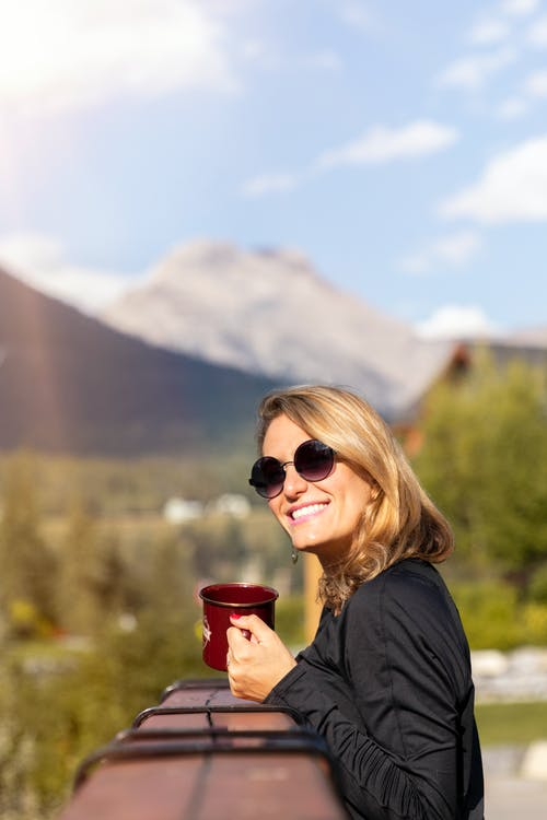 Woman Wearing Sunglasses Holding Red Cup