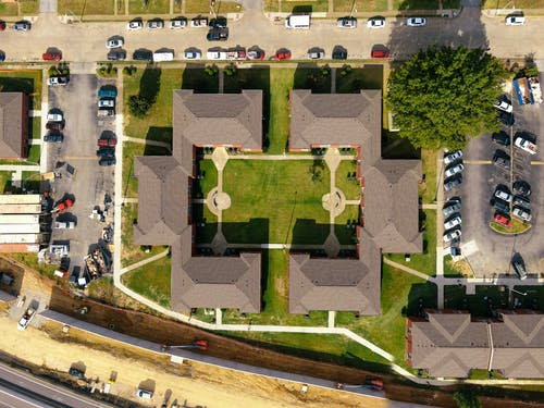 Aerial Photography of Buildings and Vehicles In A Parking Lot