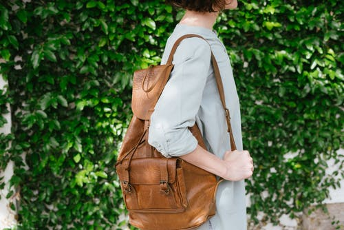 Person Carrying Brown Leather Knapsack