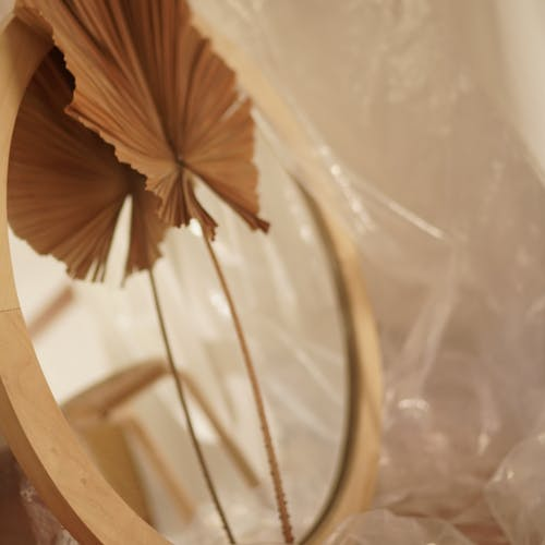 Brown Leaf on Round Brown Wooden Framed Mirror